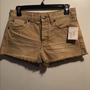 Free People denim raw hem shorts